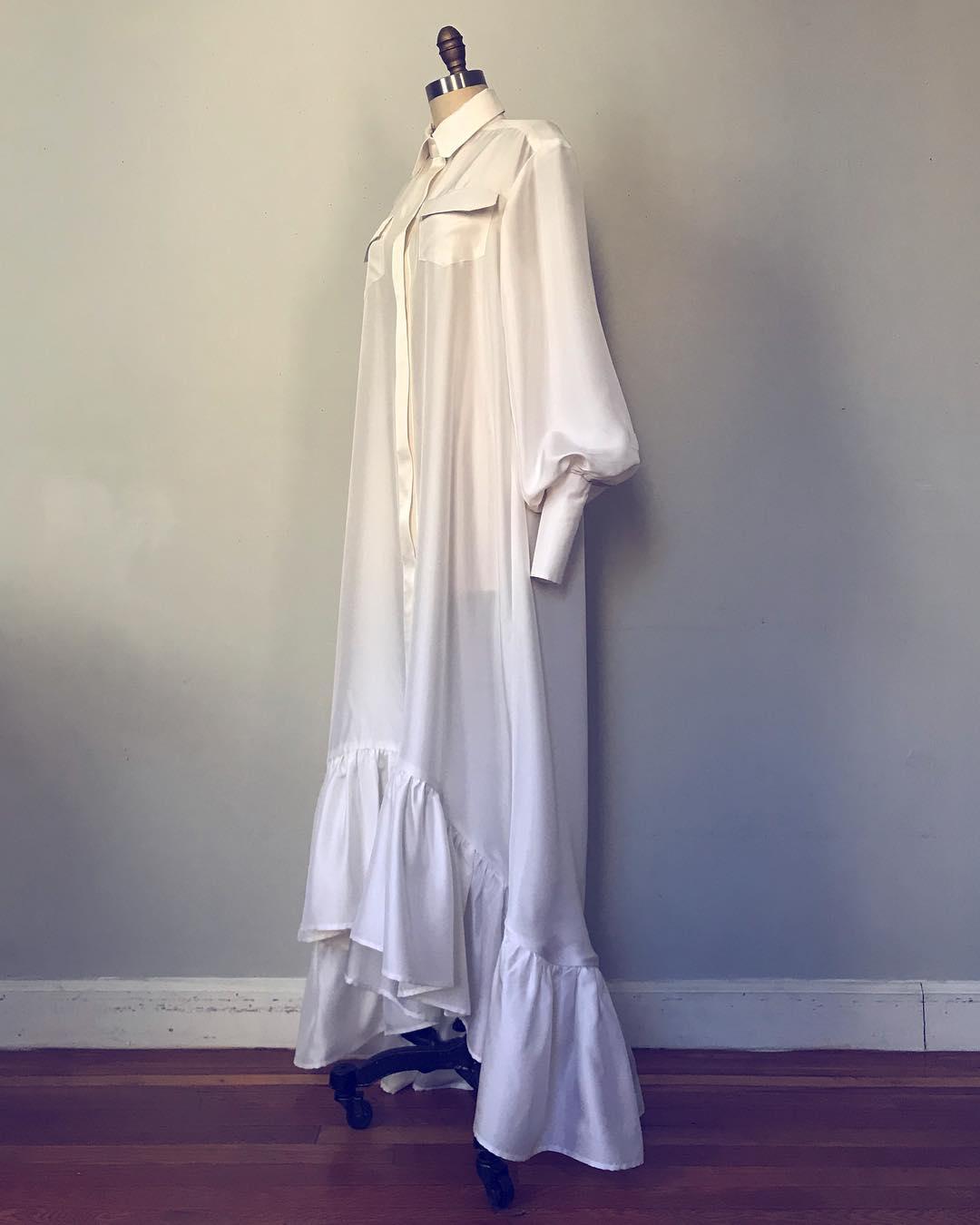 Namibia Viera_silk white dress+long sleeves and ruffles at hem.jpg