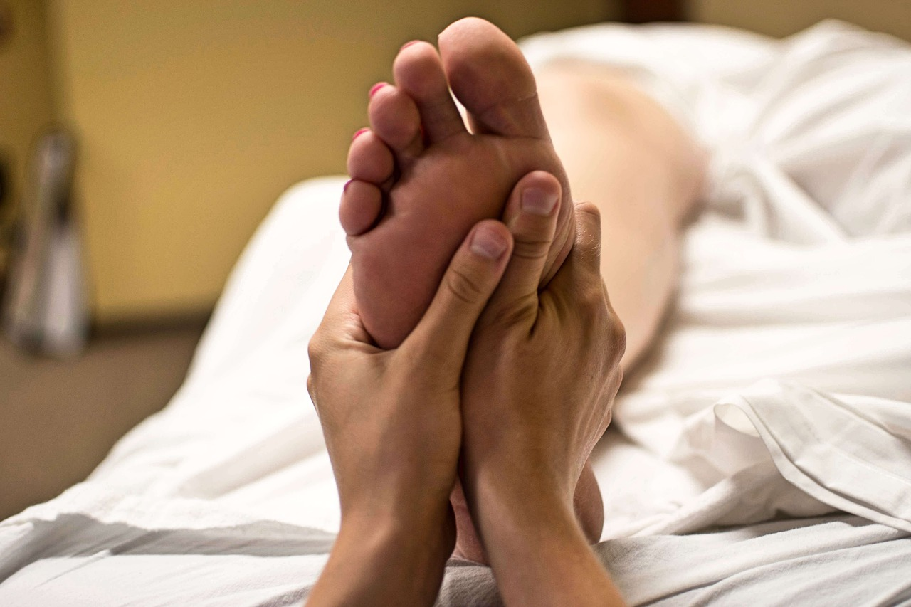 """Reflexology - Focused pressure technique directed at the feet and based on the premise that there are certain points or """"relex areas"""" on the feet and hands that are connected energetically to specific organs and body parts."""