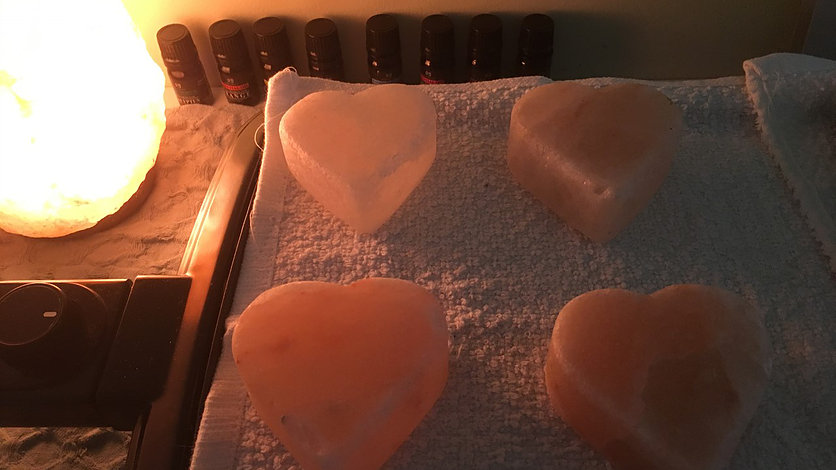 Halo Massage - Specialty massage that uses Himalayan Salt Stones containing 84 naturally occurring minerals. The minerals provide a gentle exfoliation of the skin, making the skin feel smooth and soft after your massage session. The stones also give off negative ions, which help in reducing inflammation and drawing toxins from the body.