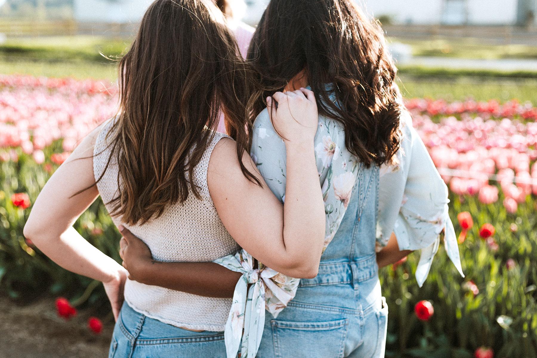 two-girls-posing-near-flowers.jpg