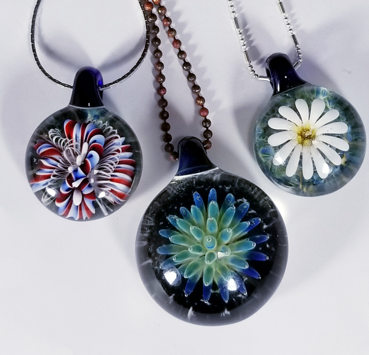 """Leslie Anne Bitgood - """"The day I turned on a torch for the first time, melted glass onto a mandrel and made my first wonky beads. I knew at that point I was addicted!""""Website"""