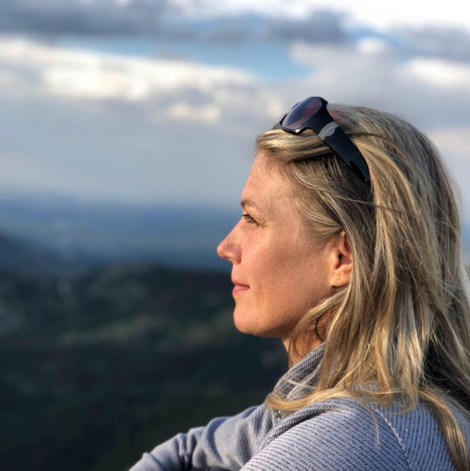 Jacquelyn Dobrinska looking out on Boulder Colorado mountains