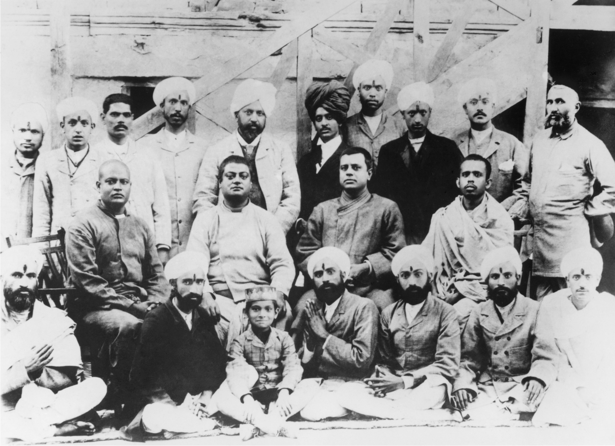 (#66) Kashmir, 1897.  Sitting on chairs  ( from  L): Swami Sadananda, Swamiji, Swami Niranjanananda, Swami Dhirananda.