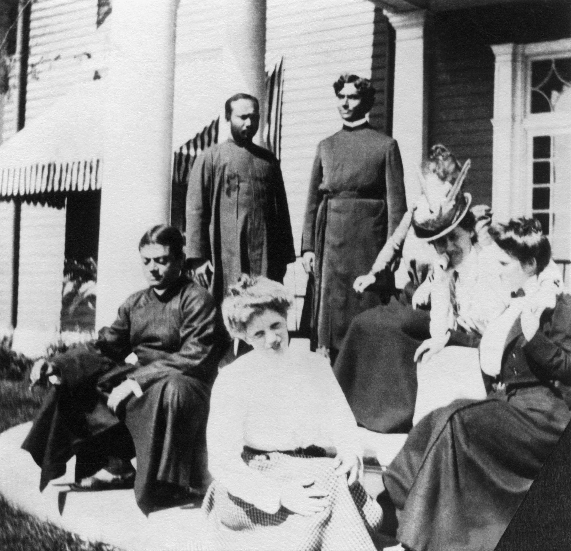 (#77) Ridgely Manor, New York. September 1899.  Standing  ( from  L): Swami Turiyananda, Swami Abhedananda.  Sitting  ( from  L): Swamiji, Alberta Sturges, Besse Leggett ( hidden ), Josephine MacLeod, and friend of Alberta's.