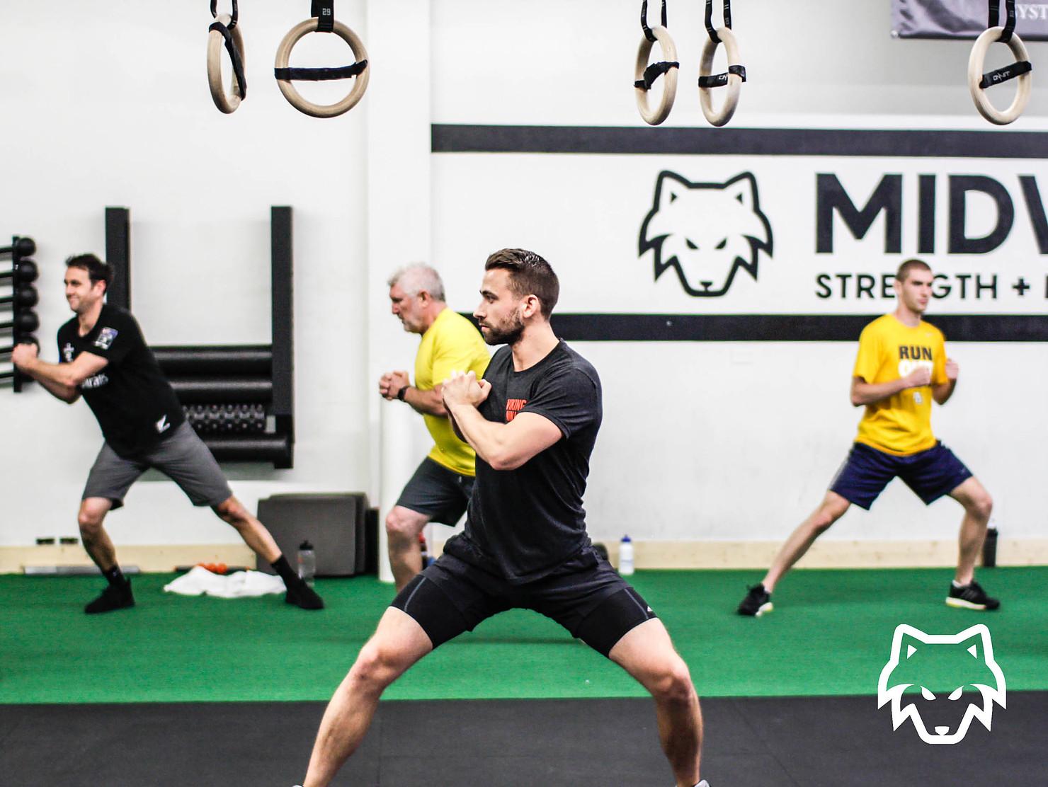 Coach Zane Roebuck's bodyweight class near Wheaton Illinois at Midwest Strength + Performance gym