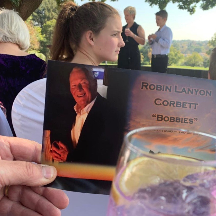 """A pic from his memorial last Friday. That's my daughter sitting there by chance and my sister and her son speaking"".  Dave Corbett, son of Robin"
