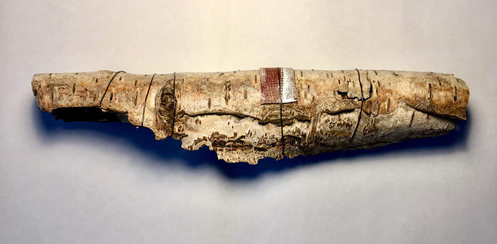 The birch bark is quite fragile so has been strengthened with enamelled copper mesh and iron wire.
