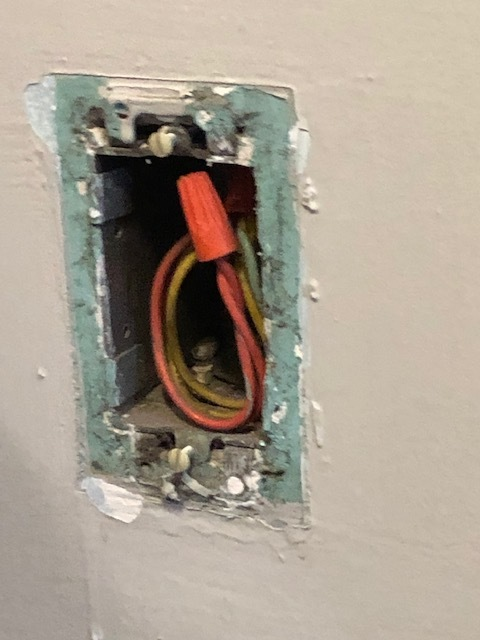 This uncovered outlet has been like this for a month or more.