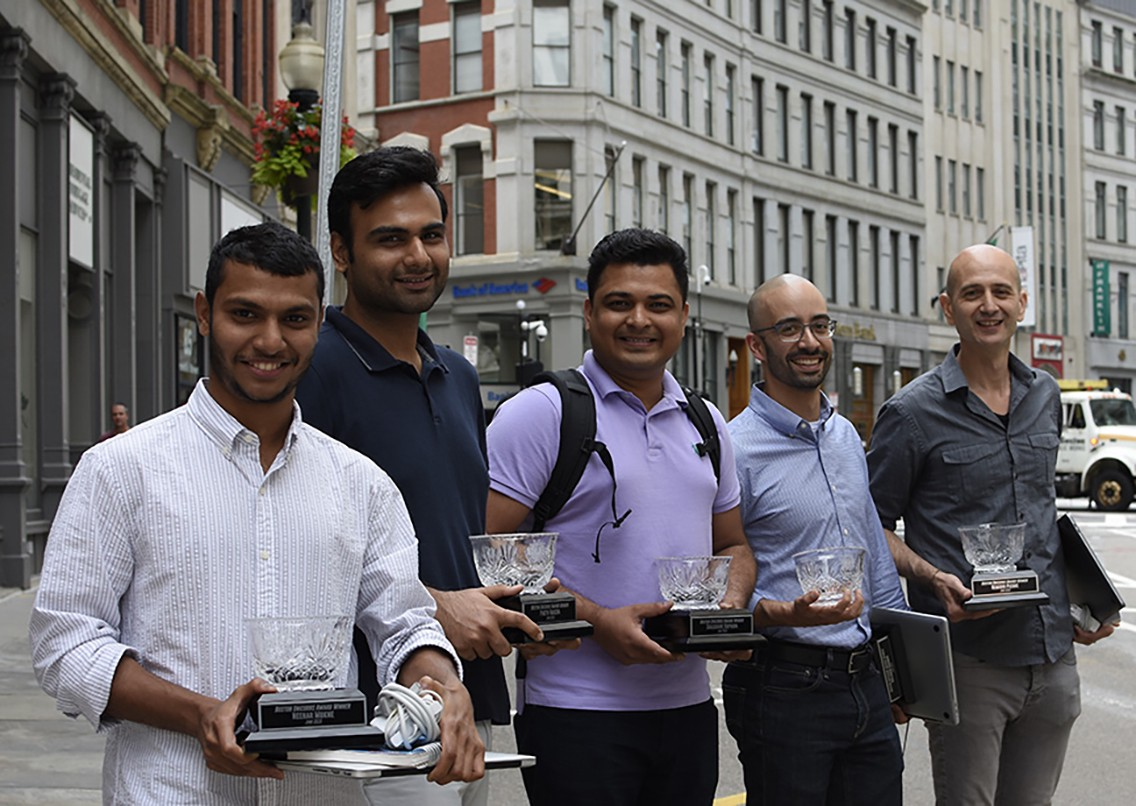 """The """"Boston Unicorns"""" hold their trophies and celebrate their win outside the Digitas Boston HQ. Pictured from left to right: Neehar Mukne, Parth Vadera, Shashank Kapadia, Luiz Freitas, Remi Picone. Not pictured: Gulsher Kooner"""