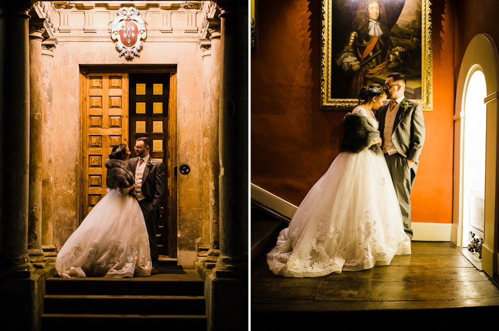 The bride and groom pose at the door to Elmore Court in Gloucester. The dress is by Milla Nova and the grooms suit by Horace Barton & Sons.