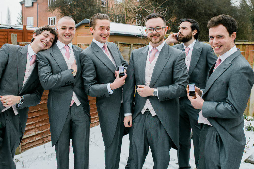 Cheltenham-Wedding-Photographer-Winter-Wedding-Groomsmen-and-Groom-Suit-By-Horace-Barton-and-Sons.jpg