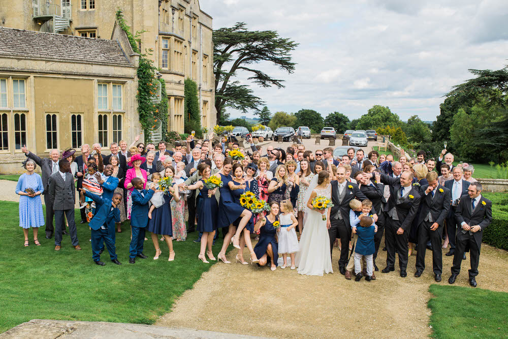 A-group-photo-of-a-wedding-at-Dumbleton-Hall-Hotel.jpg