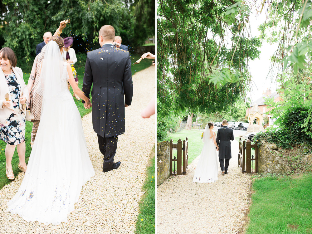 The-bride-and-groom-walk-out-of-the-church-after-confetti-in-Cheltenham.jpg