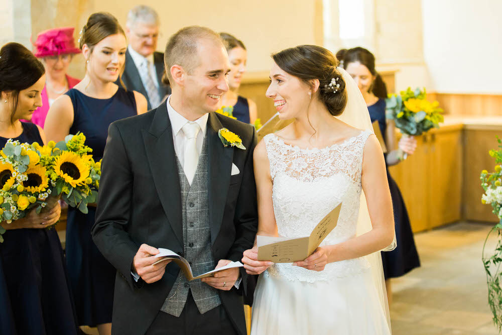 The-bridge-and-groom-laugh-at-a-wedding-in-Dumbleton.jpg