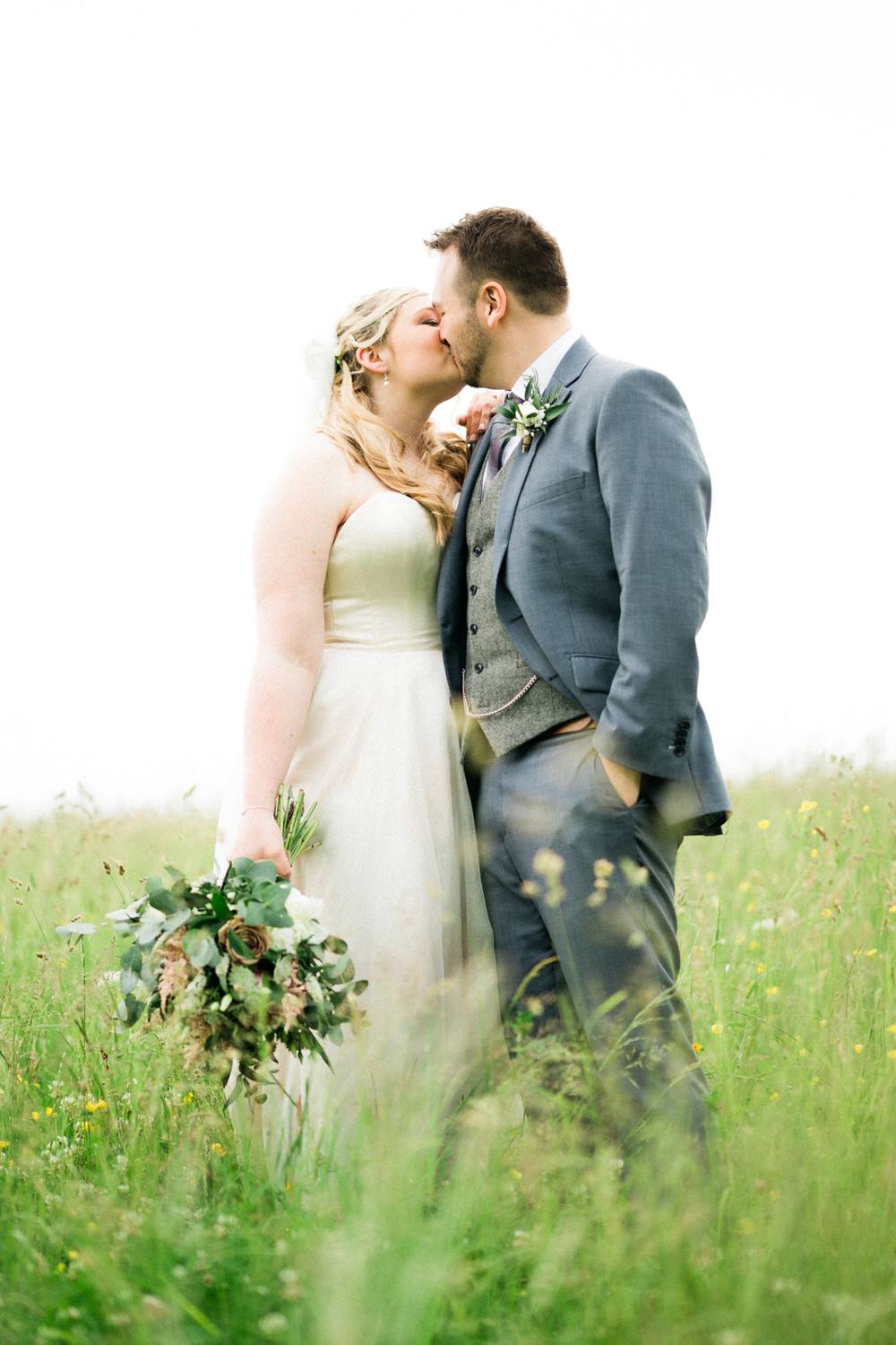 Special-Day-Photography-Cripps-Barn-Cirencester-A-bride-and-groom-kiss-during-a-wedding-couples-photoshoot-Summer-wedding-in-Cotswolds.jpg