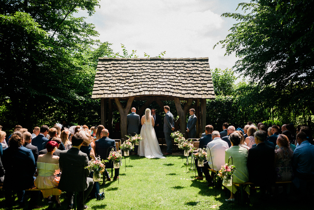 Special-Day-Photography-Cripps-Barn-Cirencester-A-ceremony-in-the-ourdoor-paddock-Wedding-venue-in-the-summer.jpg