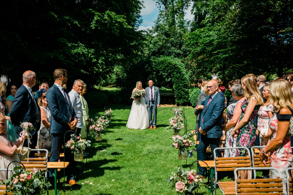 Special-Day-Photography-Cripps-Barn-Cirencester-An-outdoor-ceremony-in-the-paddock-Wedding-venue-in-the-summer.jpg