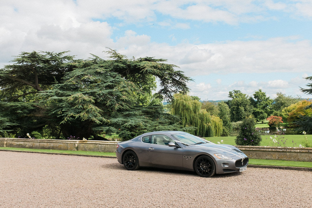 Special-Day-Photography-Dumbleton-Hall-hotel-Evensham-Mazerati-car-hire-at-a-summer-wedding.jpg