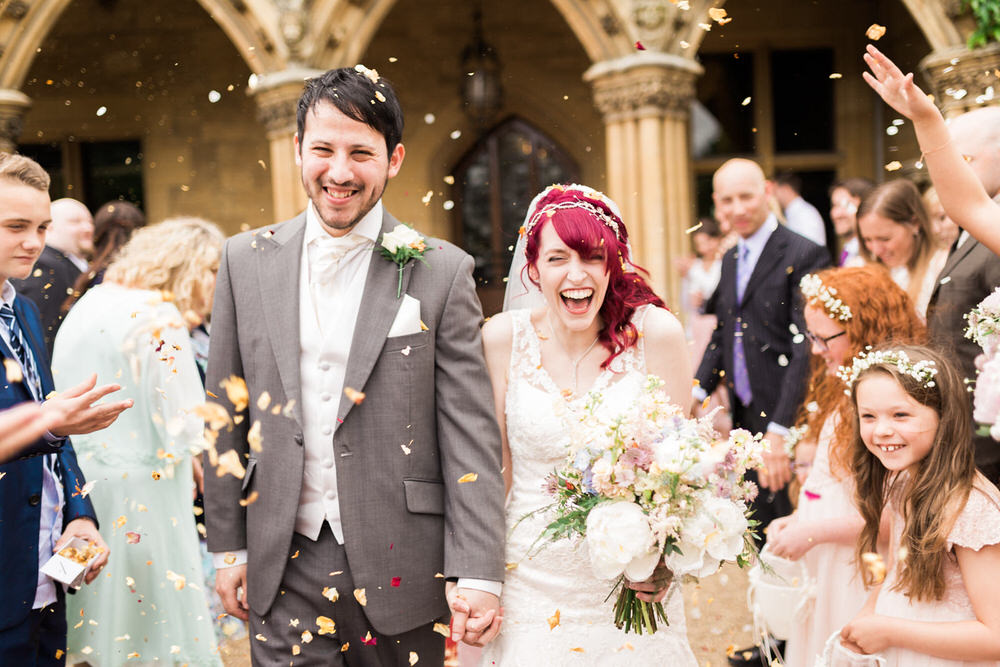Special-Day-Photography-Manor-By-the-Lake-Cheltenham-Confetti-throw-outside-the-main-doors-at-Manor-By-The-Lake.jpg