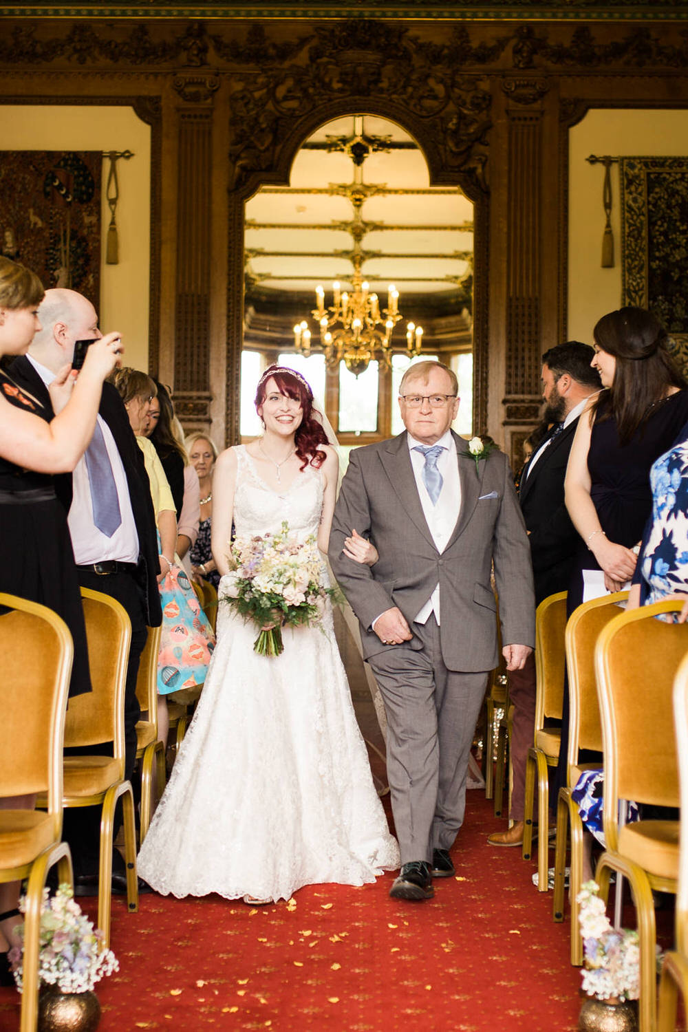 Special-Day-Photography-Manor-By-the-Lake-Cheltenham-The-Wedding-Venue-at-Manor-By-The-Lake-The-bride-walks-down-the-aisle-inside-the-venue.jpg