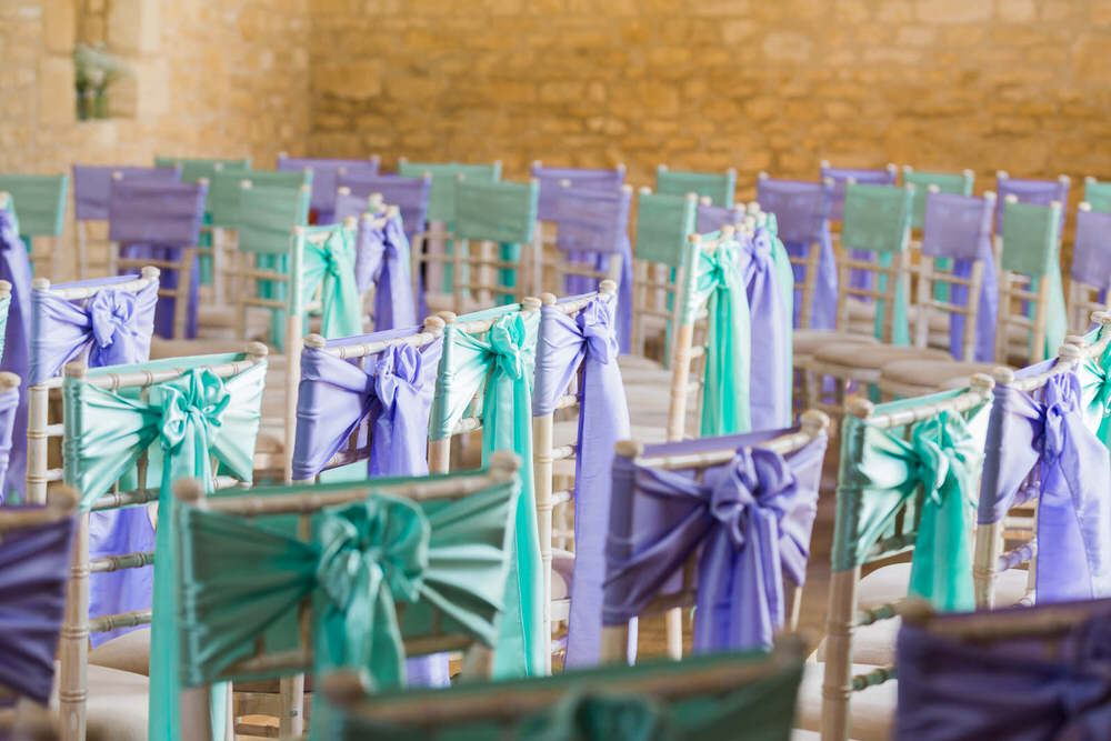 Special-Day-Photography-The-Barn-At-Upcote-Cheltenham-Chair-decorations-at-The-Barn-At-Upcote-teal-and-purple-chair-ties.jpg