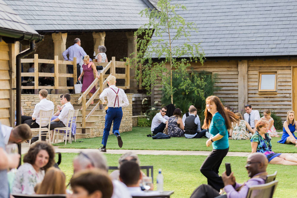 Special-Day-Photography-The-Barn-At-Upcote-Cheltenham-Guests-enjoying-the-sun-at-a-Cotswold-wedding.jpg