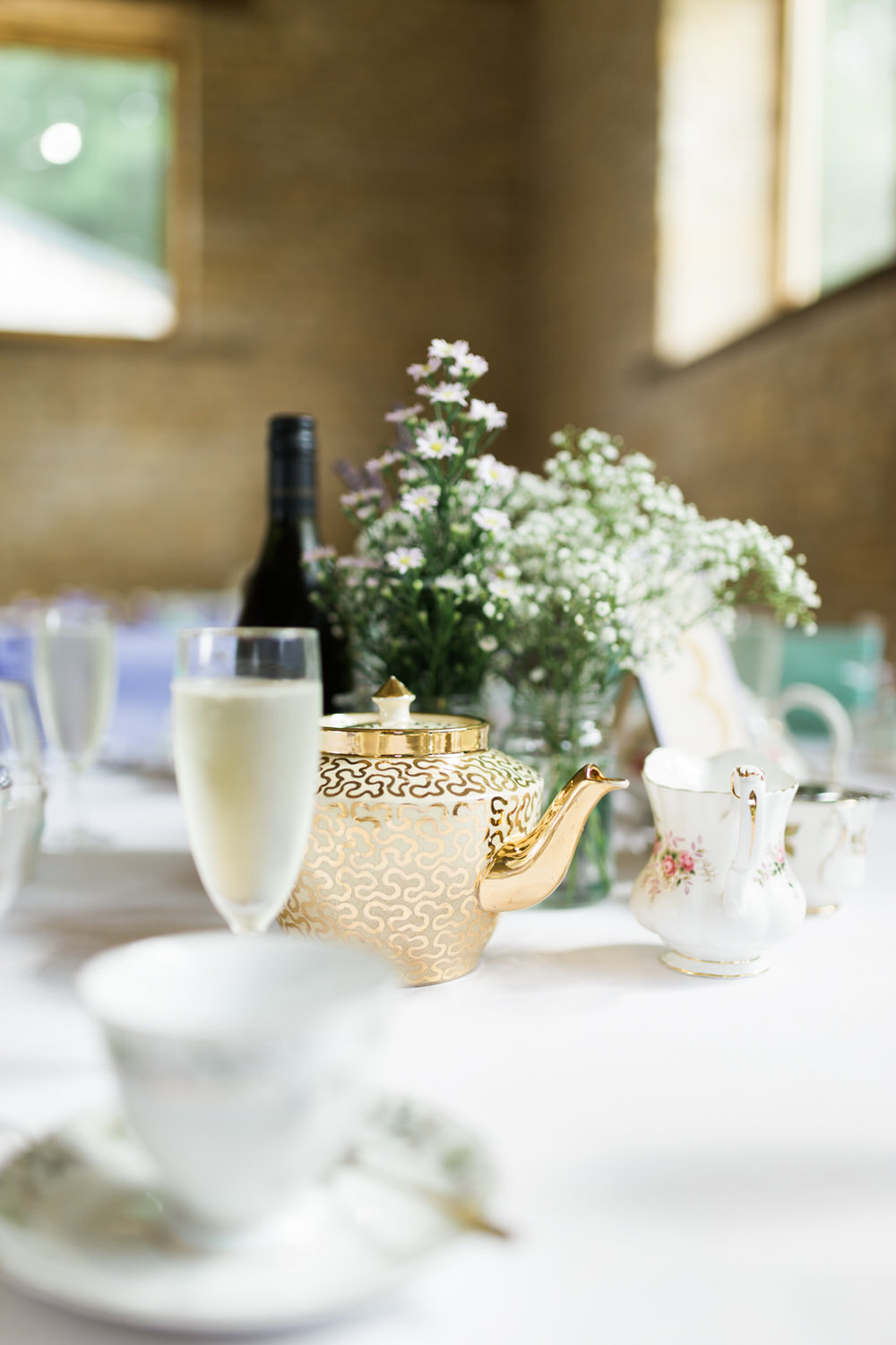 Special-Day-Photography-The-Barn-At-Upcote-Cheltenham-Table-decorations-at-The-Barn-At-Upcote-tGold-teapot-table-decorations-for-a-wedding.jpg