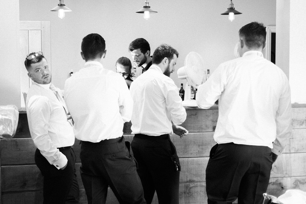 Special-Day-Photography-The-Barn-At-Upcote-Cheltenham-The-groomsmen-and-groom-have-a-drink-at-the-bar-The-Barn-At-Upcote.jpg