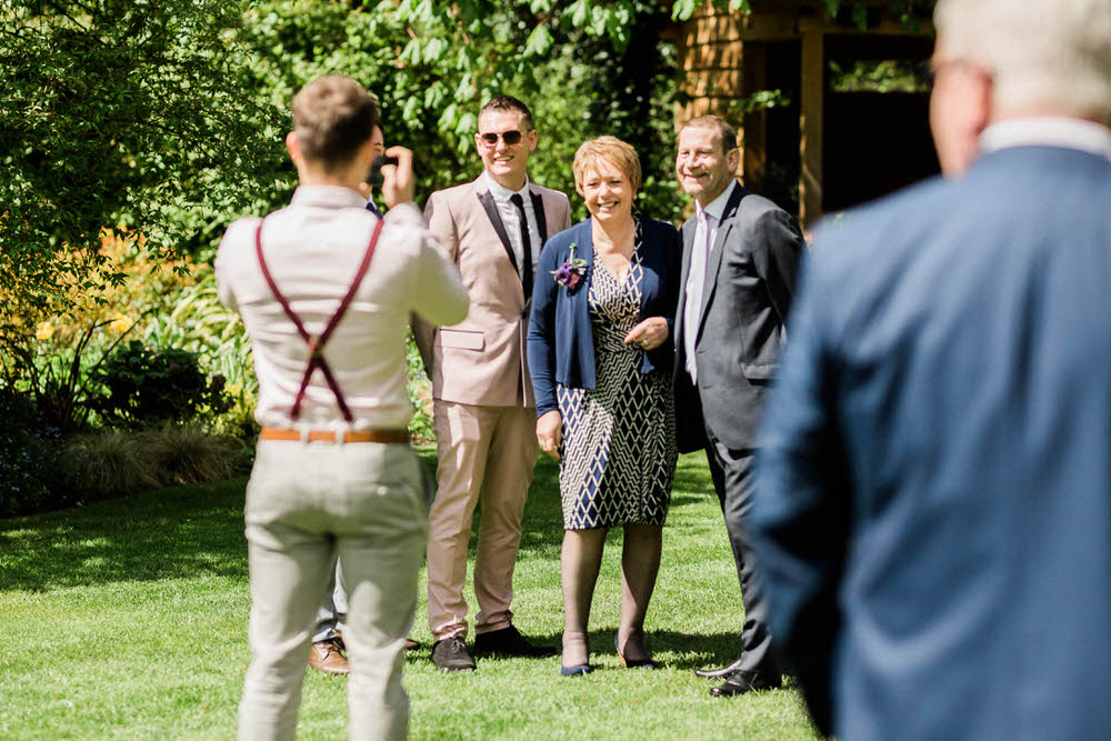 Special-Day-Photography-Egypt-Mills-Hotel-Stroud-Egypt-Mills-same-sex-wedding-Guests-posing-for-photography-at-a-wedding.jpg