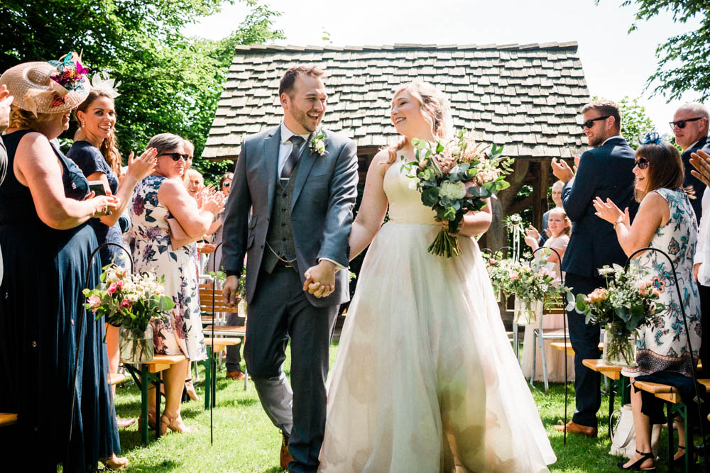 Special-Day-Photography-Cripps-Barn-Cirencester-Gloucester-Barn-Wedding-Bride-and-groom-walk-down-the-aisle-together.jpg