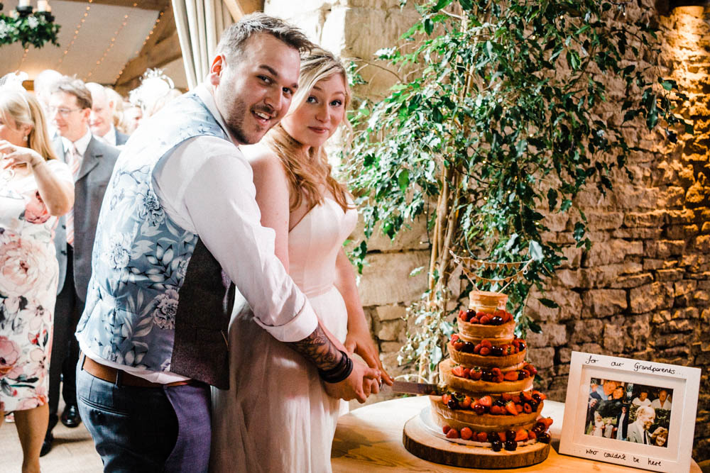 Special-Day-Photography-Cripps-Barn-Cirencester-Gloucester-Barn-Wedding-bride-and-groom-cutting-the-cake.jpg