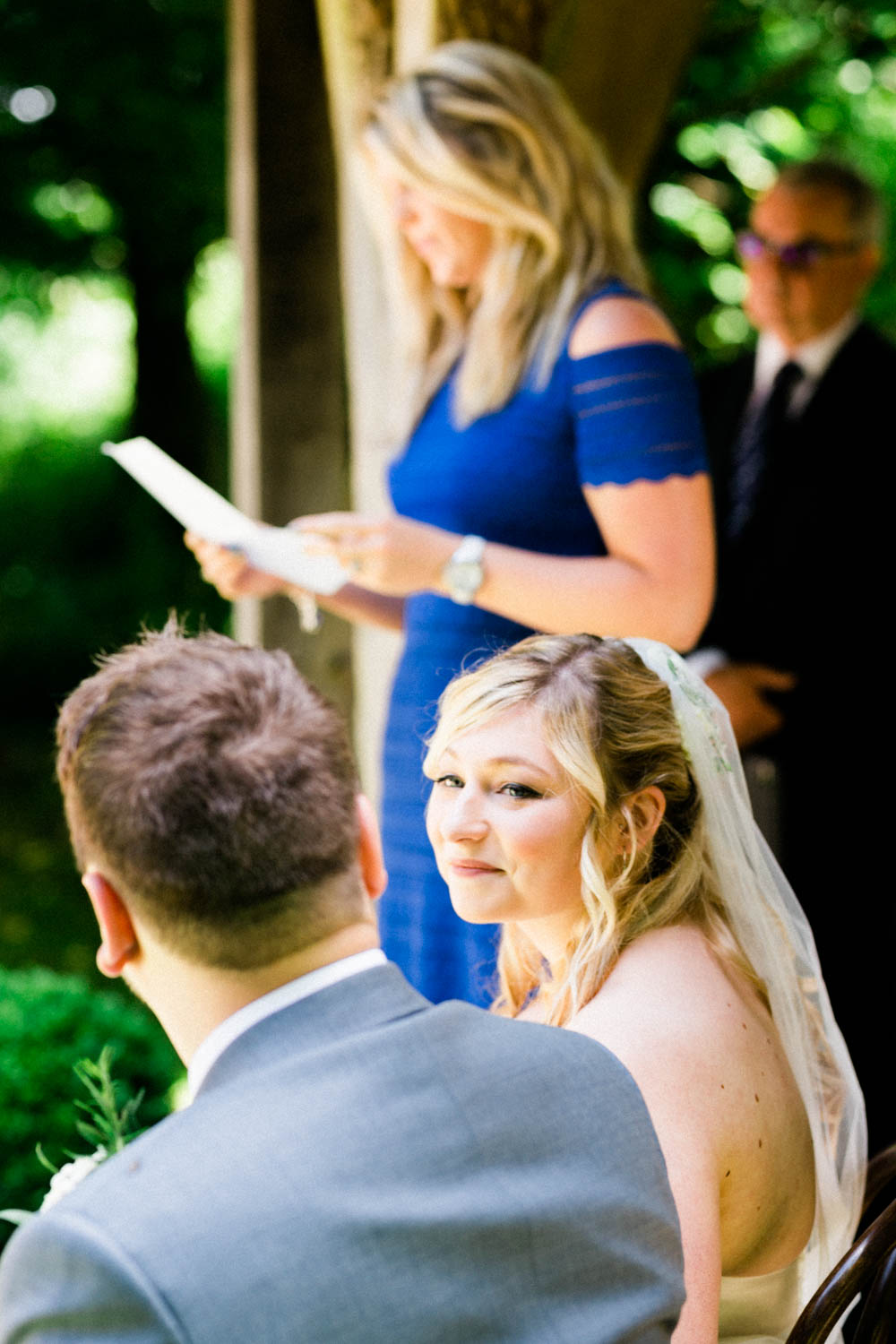 Special-Day-Photography-Cripps-Barn-Cirencester-Gloucester-Barn-Wedding-bride-exchanges-looks-during-speeches.jpg