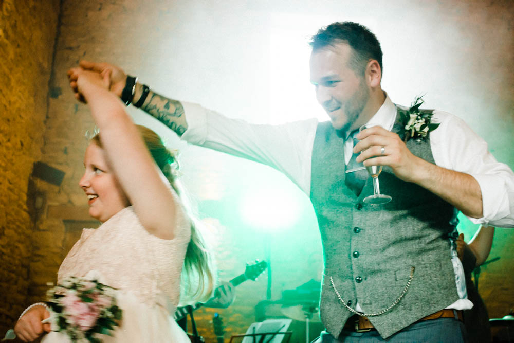 Special-Day-Photography-Cripps-Barn-Cirencester-Gloucester-Barn-Wedding-groom-dances-with-family-member.jpg