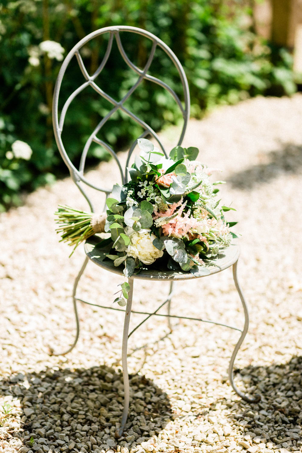 Special-Day-Photography-Cripps-Barn-Cirencester-Gloucester-Barn-Wedding-the-bridal-bouquet-on-a-rustic-chair-in-the-sun.jpg