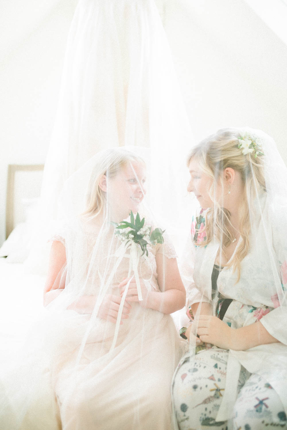 Special-Day-Photography-Cripps-Barn-Cirencester-Gloucester-Barn-Wedding-the-bride-and-neice-play-in-the-veil.jpg