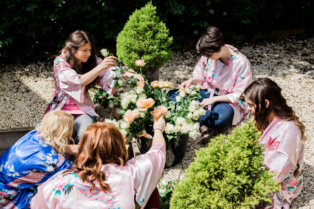 Special-Day-Photography-Cripps-Barn-Cirencester-Gloucester-Barn-Wedding-the-bridesmaids-remove-petals-for-confetti.jpg