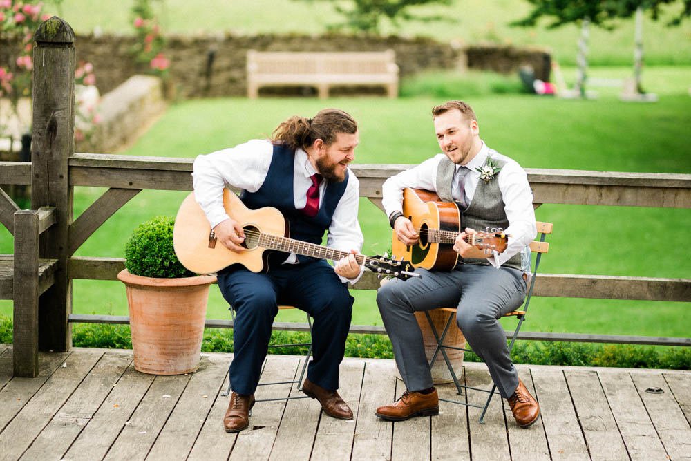 Special-Day-Photography-Cripps-Barn-Cirencester-Gloucester-Barn-Wedding-the-groom-playing-guitar-with-his-friend.jpg