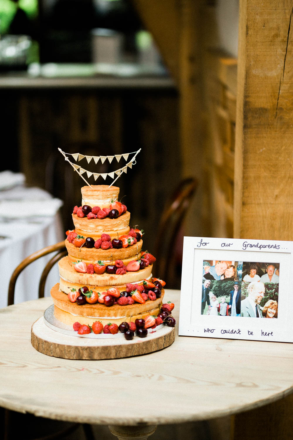 Special-Day-Photography-Cripps-Barn-Cirencester-Gloucester-Barn-Wedding-wedding-cake-with-berries.jpg