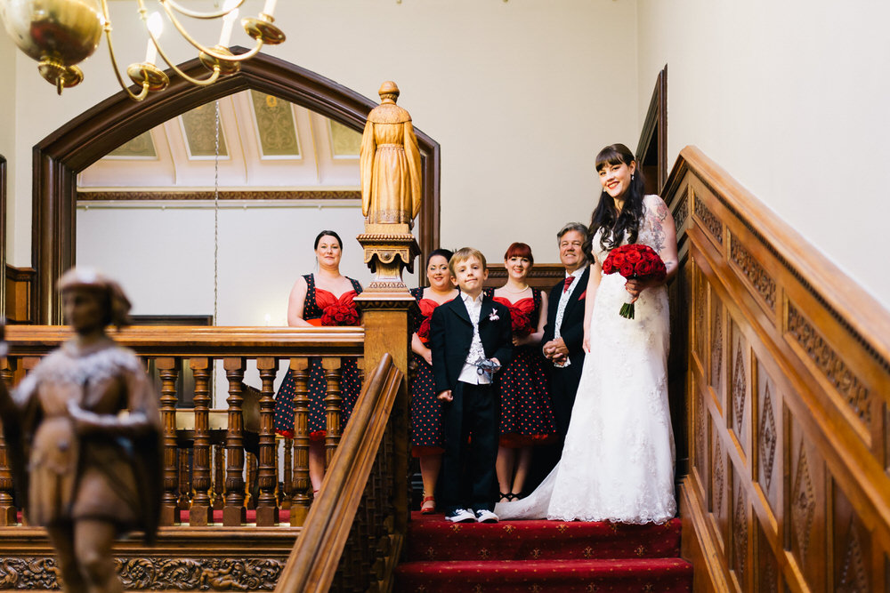 Special-Day-Photography-Manor-By-The-Lake-Cheltenham-Manor-By-The-Lake-50s-Wedding-Bride-and-family-walking-down-the-stairs.jpg