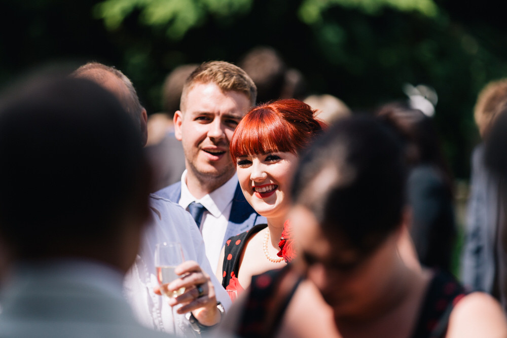 Special-Day-Photography-Manor-By-The-Lake-Cheltenham-Manor-By-The-Lake-50s-Wedding-guests-in-the-sun.jpg