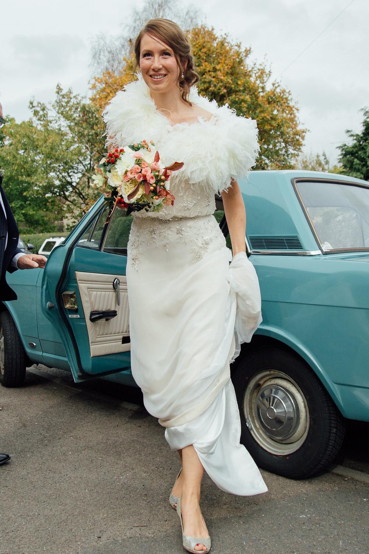 Special-Day-Photography-Prestbury-WI-Hall-Cheltenham-Prestbury-Church-Wedding-The-bride-arrives-with-fur-detail-dress.jpg