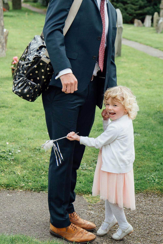 Special-Day-Photography-Prestbury-WI-Hall-Cheltenham-Prestbury-Church-Wedding-a-family-guest-with-magic-wand.jpg
