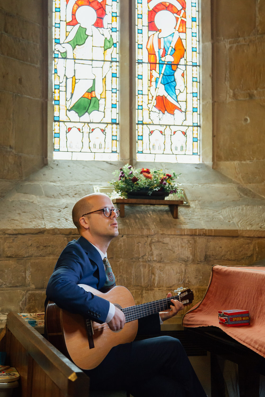 Special-Day-Photography-Prestbury-WI-Hall-Cheltenham-Prestbury-Church-Wedding-a-guitarist-at-a-wedding.jpg