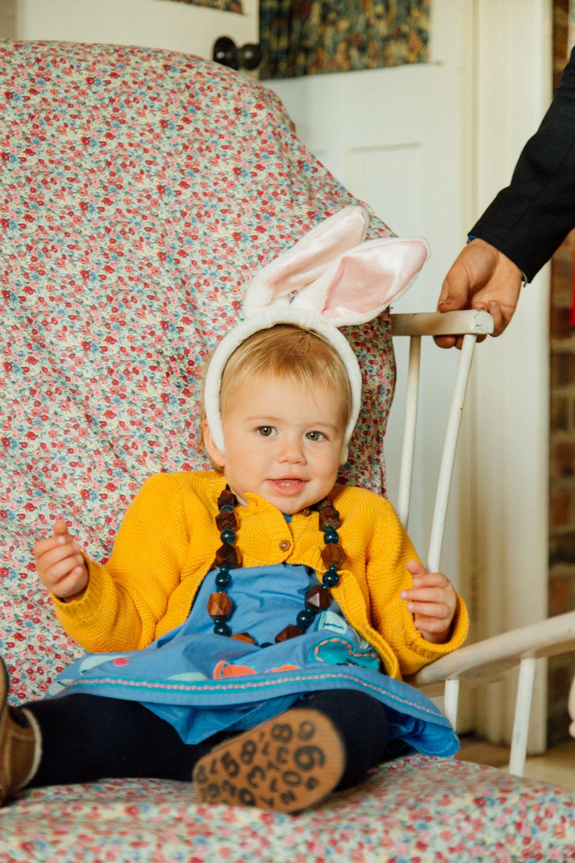 Special-Day-Photography-Prestbury-WI-Hall-Cheltenham-Prestbury-Church-Wedding-baby-with-rabbit-ears.jpg