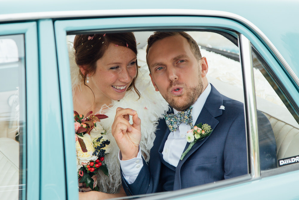 Special-Day-Photography-Prestbury-WI-Hall-Cheltenham-Prestbury-Church-Wedding-bride-and-groom-leave-in-a-car.jpg