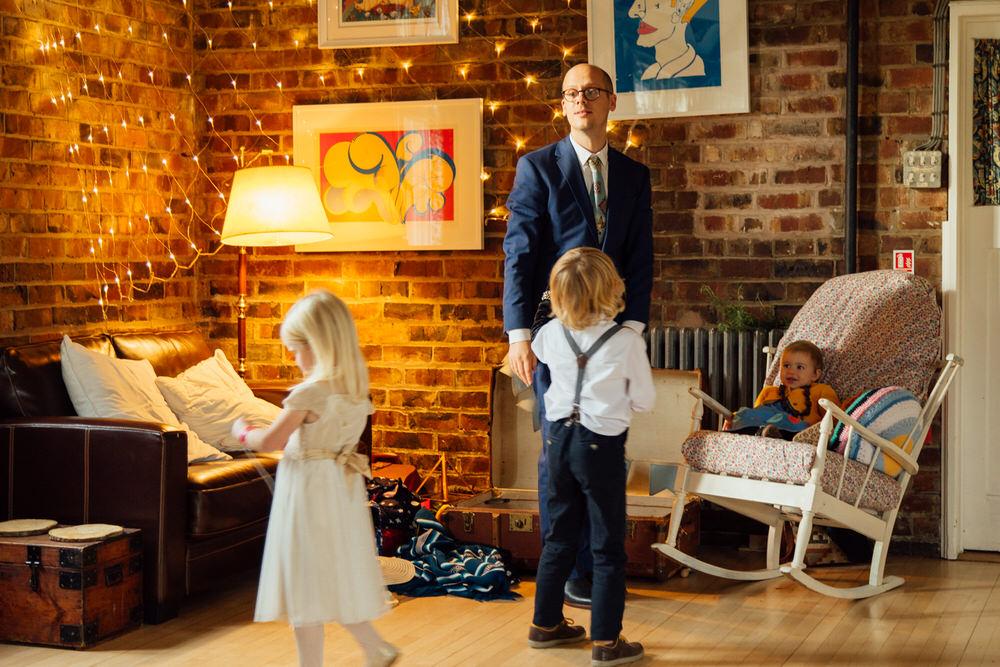 Special-Day-Photography-Prestbury-WI-Hall-Cheltenham-Prestbury-Church-Wedding-children-playing.jpg