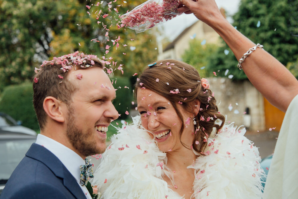 Special-Day-Photography-Prestbury-WI-Hall-Cheltenham-Prestbury-Church-Wedding-confetti-throw-over-the-grooms-head.jpg