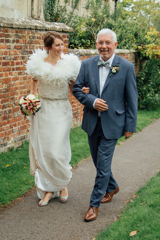 Special-Day-Photography-Prestbury-WI-Hall-Cheltenham-Prestbury-Church-Wedding-father-of-the-bride-woalks-with-the-bride.jpg