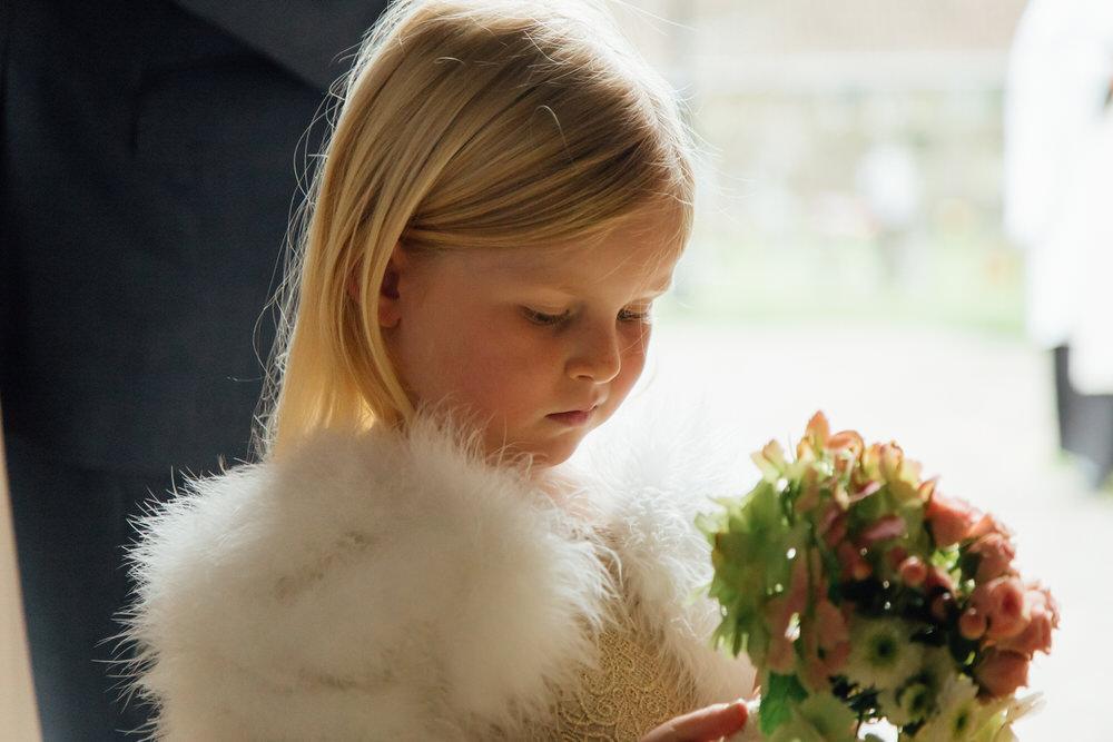 Special-Day-Photography-Prestbury-WI-Hall-Cheltenham-Prestbury-Church-Wedding-flower-girl-with-fur-trim-dress.jpg