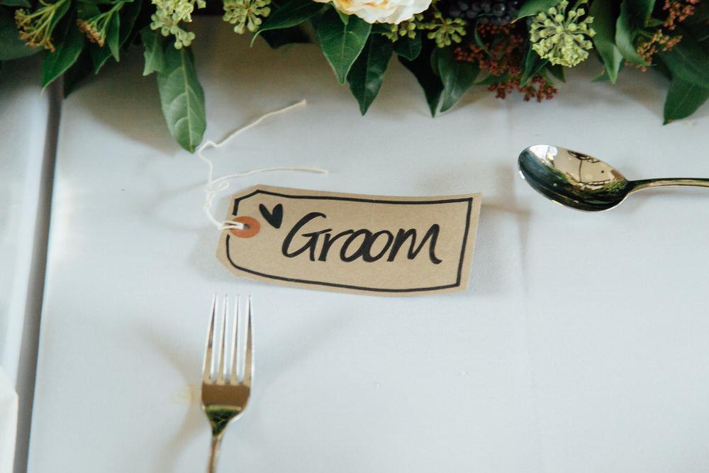 Special-Day-Photography-Prestbury-WI-Hall-Cheltenham-Prestbury-Church-Wedding-groom-placetag.jpg